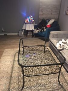 Beautiful glass coffee table with flower accent