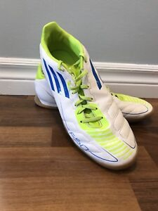 Men's Adidas indoor soccer shoes.