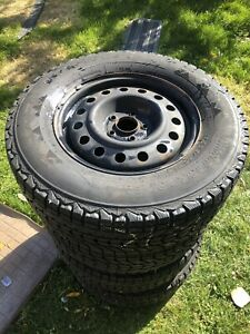 4 FIRESTONE WINTERFORCE UV TIRES ON RIMS- 235/70R16- 5x114.3