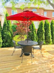 Classic outdoor dining table, chairs and umbrella