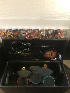 Guitar Hero Ottoman with 2 guitars, mic, drums, and 10 Games