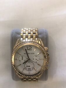 Round gold Michael Kors chronograph watch with gold band