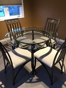 Round glass top table with 4 chairs