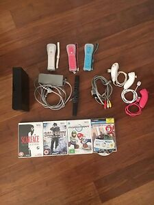 Nintendo Wii + 3 Controllers w/ nunchucks, and 5 games Woodville South Charles Sturt Area Preview