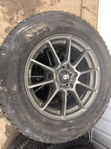 245/65R17 Blizzak Bridgestone winter tires on Sparco rims
