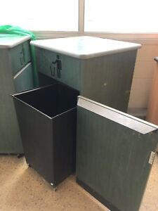Garbage bin with wooden cover.