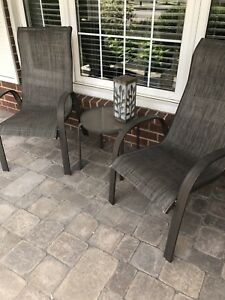 Two patio chairs with table