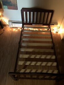 Brown wooden toddler bed