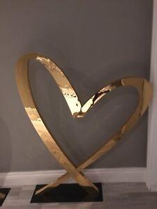 Giant gold heart wedding decor