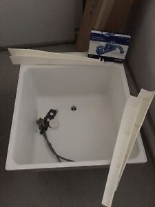 New laundry tub with faucet and supply lines