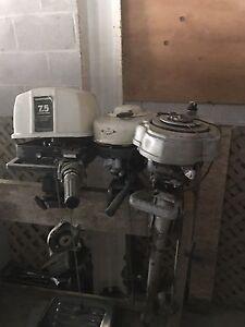 Three vintage outboard boat motors