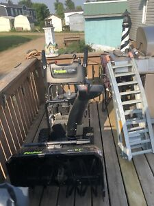 BRAND NEW SNOWBLOWER AND RAMPS.