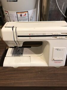 Janome sewing machine with table