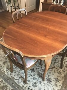 Antique solid wood table and six chairs