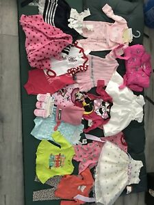 24 pieces of brand new baby girl clothing. New with tags