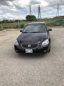 2002 Nissan Altima fully loaded , safety , clean title