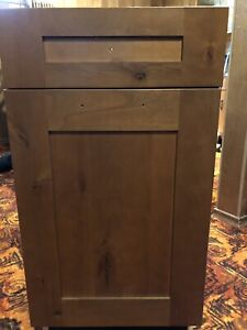 Kitchen cabinet with waste bins and drawer