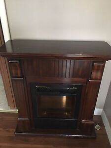 Fireplace mantle. Fireplace needs easy repair
