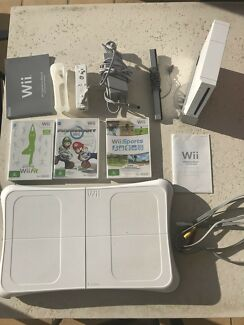 Wii console with wii fit board and games