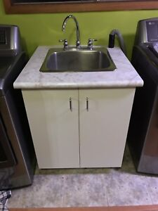 Laundry sink with tap and vanity