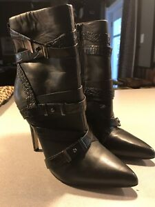 Guess high heel stiletto black boots.