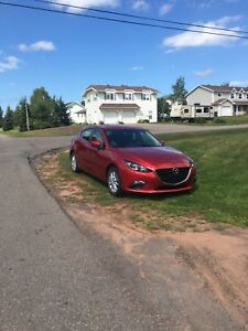 Mazda 3 for sale with alloy winter rims and tires