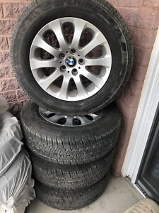 BMW mags 235/65/17 with almost brand new tires ( GoodYear)