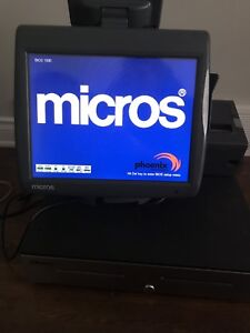 Two Micros workstations with cash drawers and printers