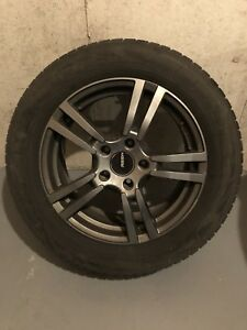 Set of snow tires and rims trust were on an Audi Q7
