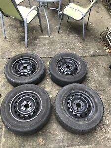 4/ 4x100mm bolt 14 inch steel wheels and tires - price flexible