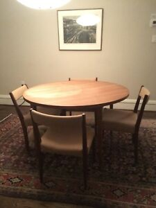 Round teak table with 4 chairs