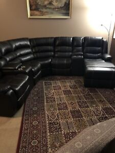 Like new -leather couch recliner
