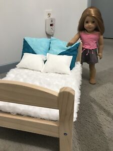 "Doll bed, pillows, linens 18"" (doll sold separately)"