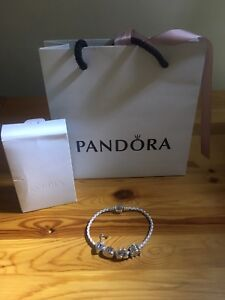 SELLING PANDORA BRACELET WITH CHARMS!!!