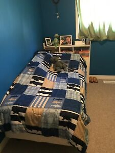 Twin bed with book shelf