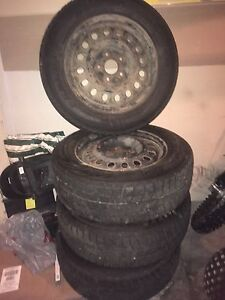 4 Winter tires on steel Rims, off of a 2008  Grand Caravan