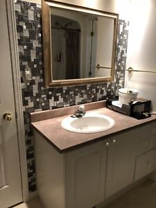 """49"""" vanity complete with sink and tap."""