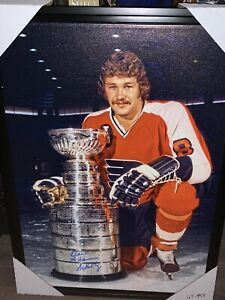 Dave the hammer Schultz autographed canvas holding the cup