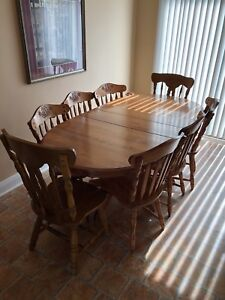 Wood dining table with extension and six chairs