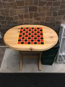 Side table with checkers board on top