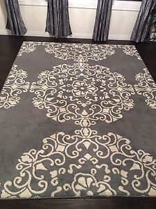 Pair of matching grey area rugs