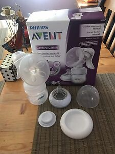 Breast pump, pads and milk storage bags 35$ for all