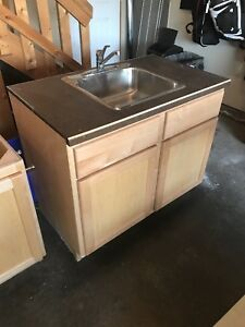 Vanity with stainless steel sink