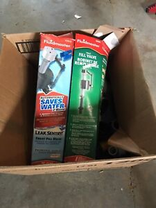 Two toilet fill valves and plumbing box