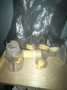 Medela Manual Breastpump with bottles
