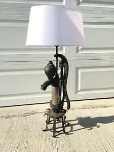 Vintage lamp made of industrial cast iron water pump