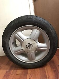 Four low miles tires and rims Fuzion 195/R15 85V