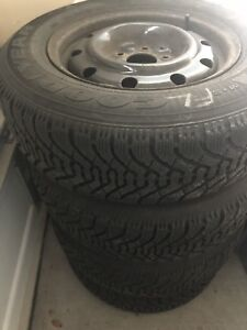 """15"""" Goodyear Nortic Winter tires 205/70r15 set of 4 w rims"""