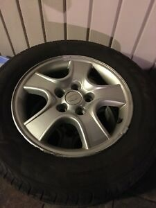 215 65R16 All season tires & Kia Sportage wheels