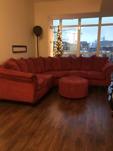 Large red suede couch and ottoman